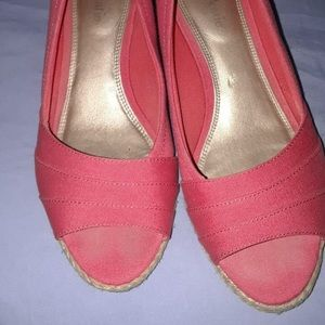 3d748ac1d036 Coral wedge espadrille with straw type heel.